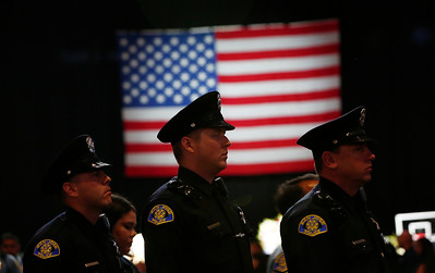 Members of the San Jose Police Department leave the memorial service for San Jose Police Department officer Michael Katherman, held at SAP Center in San Jose, Calif., on Tuesday, June 21, 2016. Katherman was killed in a traffic collision while on patrol on his police motorcycle last week. (Photo by Gary Reyes/Bay Area News Group)