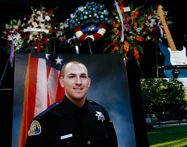 A portrait of San Jose Police Department officer  Michael Katherman sits at the front of the stage before his memorial service at SAP Center in San Jose, Calif., on Tuesday, June 21, 2016. Katherman was killed in a traffic collision while on patrol on his police motorcycle last week. (Photo by Gary Reyes/Bay Area News Group)