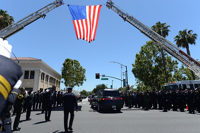 The recessional leaves following a memorial for fallen San Jose police officer Michael Katherman at the SAP Center in San Jose, Calif., on Tuesday, June 21, 2016. Katherman died June 14 when his police motorcycle collided with a minivan at North 10th and Horning streets. He was the city's 13th police officer killed in the line of duty and the second motorcycle officer. (Dan Honda/Bay Area News Group)