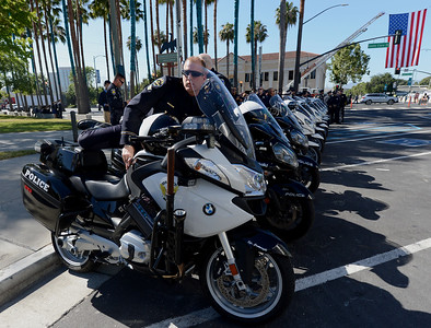 Logan Cartwright, of the Oakley Police Department, arrives at a memorial for fallen San Jose police officer Michael Katherman at the SAP Center in San Jose, Calif., on Tuesday, June 21, 2016. Katherman died June 14 when his police motorcycle collided with a minivan at North 10th and Horning streets. He was the city's 13th police officer killed in the line of duty and the second motorcycle officer. (Dan Honda/Bay Area News Group)