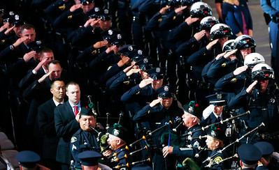 A final salute by fellow officers is given during a memorial service for San Jose Police Department officer Michael Katherman, held at SAP Center in San Jose, Calif., on Tuesday, June 21, 2016. Katherman was killed in a traffic collision while on patrol on his police motorcycle last week. (Photo by Gary Reyes/Bay Area News Group)
