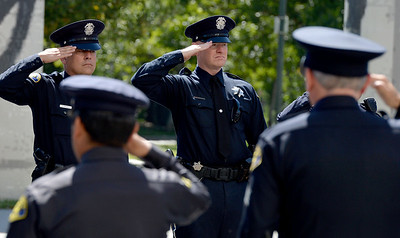 Police officers salute as the funeral procession passes by at a memorial for fallen San Jose police officer Michael Katherman at the SAP Center in San Jose, Calif., on Tuesday, June 21, 2016. Katherman died June 14 when his police motorcycle collided with a minivan at North 10th and Horning streets. He was the city's 13th police officer killed in the line of duty and the second motorcycle officer. (Dan Honda/Bay Area News Group)