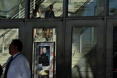 A photograph of the late officer photographed as people begin to arrive to a memorial for fallen San Jose police officer Michael Katherman at the SAP Center in San Jose, Calif., on Tuesday, June 21, 2016. Katherman died June 14 when his police motorcycle collided with a minivan at North 10th and Horning streets. He was the city's 13th police officer killed in the line of duty and the second motorcycle officer. (Dan Honda/Bay Area News Group)
