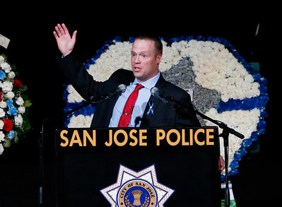 Michael Whittington, of the Santa Clara County District Attorney's Office, gives his remarks during a memorial service for San Jose Police Department officer Michael Katherman, held at SAP Center in San Jose, Calif., on Tuesday, June 21, 2016. Katherman was killed in a traffic collision while on patrol on his police motorcycle last week. (Photo by Gary Reyes/Bay Area News Group)