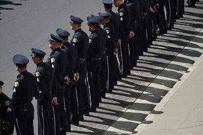 Police officers line the street as a funeral procession passes by at a memorial for fallen San Jose police officer Michael Katherman at the SAP Center in San Jose, Calif., on Tuesday, June 21, 2016. Katherman died June 14 when his police motorcycle collided with a minivan at North 10th and Horning streets. He was the city's 13th police officer killed in the line of duty and the second motorcycle officer. (Dan Honda/Bay Area News Group)