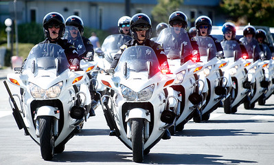 Motorcycle police officers from throughout the state accompany their fallen colleague, San Jose police officer Michael Katherman, in a procession to his memorial service at SAP Center, Tuesday morning, June 21, 2016, in San Jose, Calif.(Karl Mondon/Bay Area News Group)