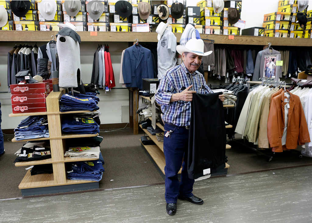 . Jose Mendoza, 76, owner of San Jose Men\'s Wear, waits to help customers during the final days before he closes the store for good in San Jose, Calif. on Monday, July 29, 2013. Mendoza has owned the store located in the Tropicana Shopping Center since 1982. The store specializes in Mexican western wear for men.  (Gary Reyes/Bay Area News Group)