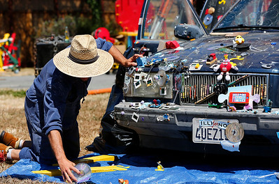 Doug Marks prepares a car that will be used for the Life Size Mousetrap show during final preparations for the opening of the San Mateo County Fair in San Mateo, Calif., on Friday, June 10, 2016. The fair opens Saturday and runs through Sunday, June 19, 2016. (Gary Reyes/Bay Area News Group)