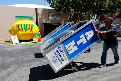 Portable ATM's are rolled into the fairgrounds during final preparations for the opening of the San Mateo County Fair in San Mateo, Calif., on Friday, June 10, 2016. The fair opens Saturday and runs through Sunday, June 19, 2016. (Gary Reyes/Bay Area News Group)