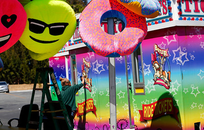 Dixie Schilling cleans up the ticket booths during final preparations for the opening of the San Mateo County Fair in San Mateo, Calif., on Friday, June 10, 2016. The fair opens Saturday and runs through Sunday, June 19, 2016. (Gary Reyes/Bay Area News Group)