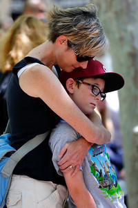 Amanda Burke-Aaronson, holds her son, CJ Aaronson, 10, both of Mountain View, during a memorial at the County Government Center in San Jose, Calif., on Monday, June 13, 2016. The memorial and LGBT half-mast flag raising honored victims of the mass shooting at an Orlando, Fla., nightclub that occurred early yesterday morning. (Gary Reyes/Bay Area News Group)
