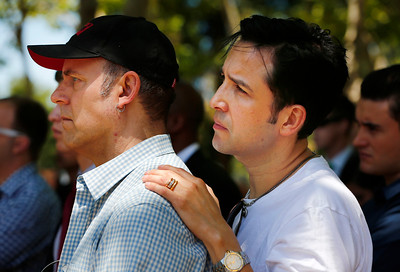 Robert Fletcher and Nick Raygoza, both of San Jose, listen to speakers during a memorial at the County Government Center in San Jose, Calif., on Monday, June 13, 2016. The memorial and LGBT half-mast flag raising honored victims of the mass shooting at an Orlando, Fla., nightclub that occurred early yesterday morning. (Gary Reyes/Bay Area News Group)