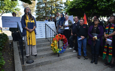 Members of the local clergy speak during a vigil at the 1220 Club in Walnut Creek, Calif., on Monday, June 13, 2016. The vigil, put on by the 1220 Club, Rainbow Community Center and other LGBT and religious organizations, was in support and to remember those who died in the Orlando shooting. (Dan Honda/Bay Area News Group)