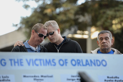Andrew Fowler, left, and Donald Fowler, center, both of Concord pray during a vigil at the 1220 Club in Walnut Creek, Calif., on Monday, June 13, 2016. The vigil, put on by the 1220 Club, Rainbow Community Center and other LGBT and religious organizations, was in support and to remember those who died in the Orlando shooting. (Dan Honda/Bay Area News Group)