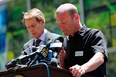 Bryan Franzen, pastor of the Westminster Presbyterian Church, offers a prayer during a memorial at the County Government Center in San Jose, Calif., on Monday, June 13, 2016. The memorial and LGBT half-mast flag raising honored victims of the mass shooting at an Orlando, Fla., nightclub that occurred early yesterday morning. At left is Santa Clara County Supervisor, Ken Yeager. (Gary Reyes/Bay Area News Group)