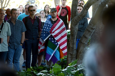 People gather during a vigil at the 1220 Club in Walnut Creek, Calif., on Monday, June 13, 2016. The vigil, put on by the 1220 Club, Rainbow Community Center and other LGBT and religious organizations, was in support and to remember those who died in the Orlando shooting. (Dan Honda/Bay Area News Group)