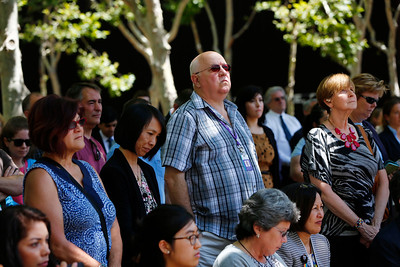 A large crowd solemnly listens to speakers during a memorial held at the County Government Center in San Jose, Calif., on Monday, June 13, 2016. The memorial and LGBT half-mast flag raising honored victims of the mass shooting at an Orlando, Fla., nightclub that occurred early yesterday morning. (Gary Reyes/Bay Area News Group)