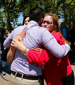 Omar Torres, gets a hug from Magdalena Carrasco, left and Cindy Chavez during a memorial at the County Government Center in San Jose, Calif., on Monday, June 13, 2016. The memorial and LGBT half-mast flag raising honored victims of the mass shooting at an Orlando, Fla., nightclub that occurred early yesterday morning. Magdalena is the District 5 San Jose Councilmember. Cindy Chavez is a Santa Clara County Supervisor. (Gary Reyes/Bay Area News Group)