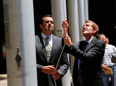 Sam Liccardo, San Jose mayor, and Ken Yeager, Santa Clara County supervisor, raise the LBGT flag to half-mast during a memorial at the County Government Center in San Jose, Calif., on Monday, June 13, 2016. The memorial and LGBT flag raising honored victims of the mass shooting at an Orlando, Fla., nightclub that occurred early yesterday morning. (Gary Reyes/Bay Area News Group)