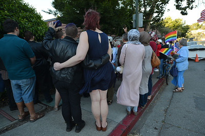 A couple holds each other during a vigil at the 1220 Club in Walnut Creek, Calif., on Monday, June 13, 2016. The vigil, put on by the 1220 Club, Rainbow Community Center and other LGBT and religious organizations, was in support and to remember those who died in the Orlando shooting. (Dan Honda/Bay Area News Group)