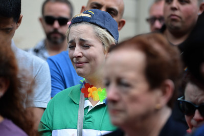 Daphne Call, center, of Pleasant Hill, cries during a vigil at the 1220 Club in Walnut Creek, Calif., on Monday, June 13, 2016. The vigil, put on by the 1220 Club, Rainbow Community Center and other LGBT and religious organizations, was in support and to remember those who died in the Orlando shooting. (Dan Honda/Bay Area News Group)