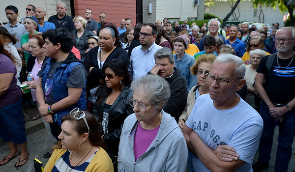People listen to the reading of the names of those killed in the Orlando shootings during a vigil at the 1220 Club in Walnut Creek, Calif., on Monday, June 13, 2016. The vigil, put on by the 1220 Club, Rainbow Community Center and other LGBT and religious organizations, was in support and to remember those who died in the Orlando shooting. (Dan Honda/Bay Area News Group)
