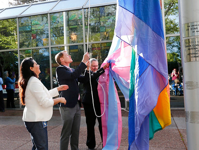 Maribel Martinez, Santa Clara County Supervisor, Ken Yeager, and Lance Moore, left to right, raise the Transgender Pride Flag in front of the County Government Center for the first time in front of any Santa Clara County building in San Jose, Calif., on Tuesday, March 22, 2016. The flag raising ceremony was held in advance of the sixth annual International Transgender Day of Visibility on March 31, 2016, and kick off LGBTQ events through April, including Santa Clara County's South Bay Transgender Day of Visibility on April 2, 2016. Martinez is the manager of the county office of LGBTQ affairs. Moore is a local transgender rights activist. (Gary Reyes/Bay Area News Group)