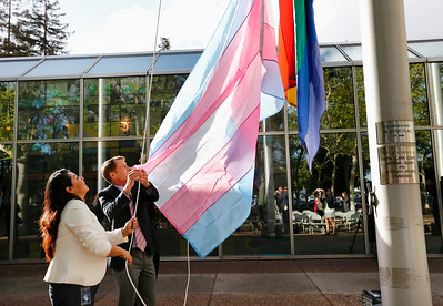 Maribel Martinez, manager of the county office of LGBTQ affairs, left, Santa Clara County Supervisor, Ken Yeager, and Lance Moore, behind flag, raise the Transgender Pride Flag in front of the County Government Center for the first time in front of any Santa Clara County building in San Jose, Calif., on Tuesday, March 22, 2016. The flag raising ceremony was held held in advance of the sixth annual International Transgender Day of Visibility on March 31, 2016, and kick off LGBTQ events through April, including Santa Clara County's South Bay Transgender Day of Visibility on April 2, 2016.(Gary Reyes/Bay Area News Group)