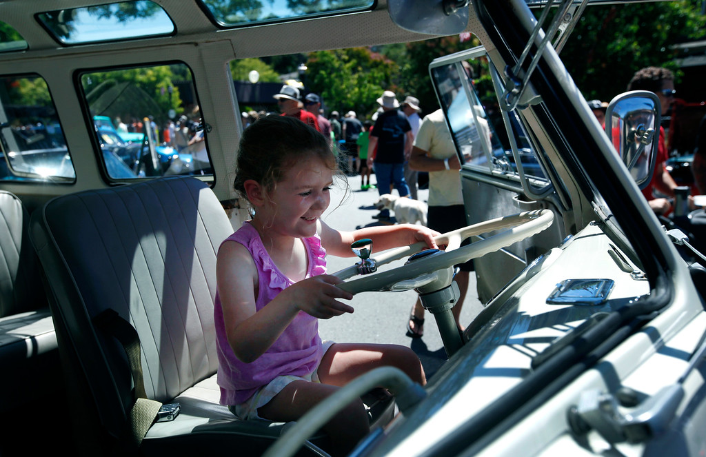 . Lexi Palfalvi, 3, sits in the driver seat of Jim Christian\'s 21-window, \'67 Volkswagen Bus on display at the Saratoga Classic Car Show in Saratoga, Calif., Sunday, July 17, 2016. (Karl Mondon/Bay Area News Group)
