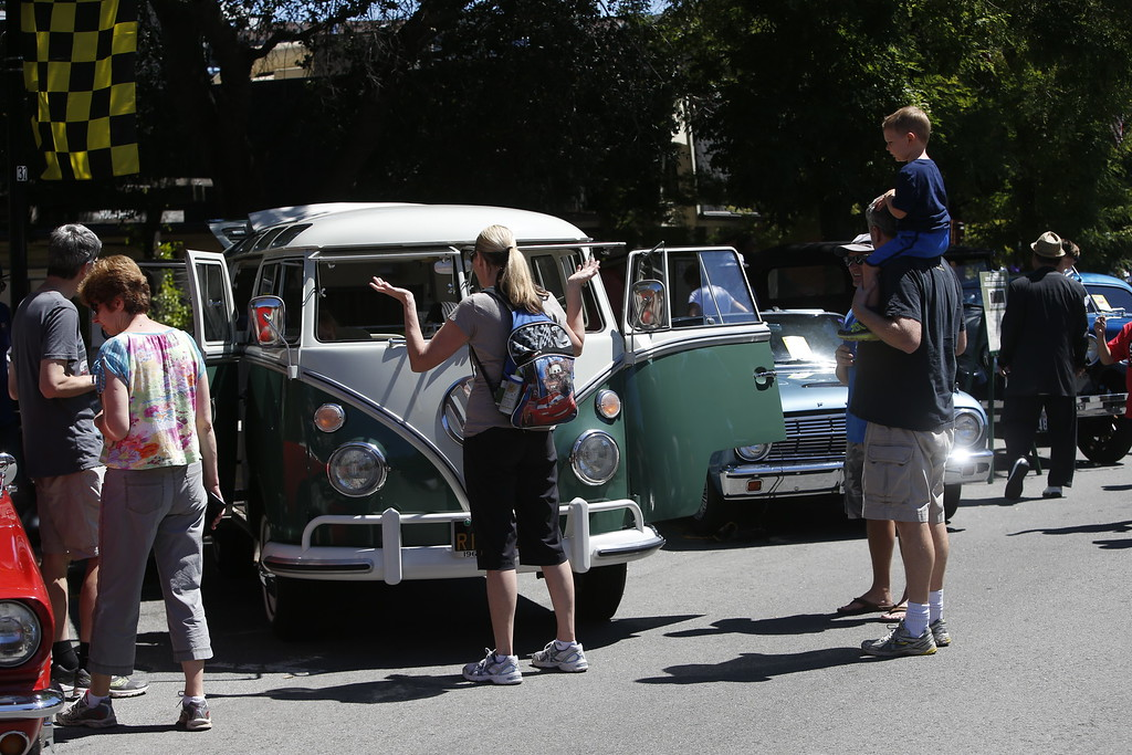 . Lori Palvalvi waits for her 3-year-old daughter, Lexi, to get out of Jim Christian\'s 21-window, \'67 Volkswagen Bus on display at the Saratoga Classic Car Show in Saratoga, Calif., Sunday, July 17, 2016. (Karl Mondon/Bay Area News Group)