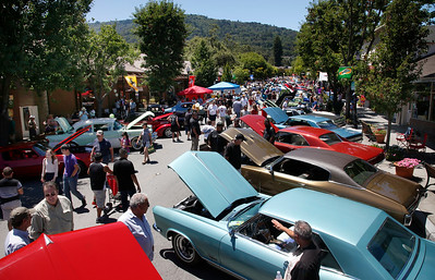 Large crowds mill among the vehicles entered in the Saratoga Classic Car Show on Big Basin Way in Saratoga, Calif., Sunday, July 17, 2016. (Karl Mondon/Bay Area News Group)