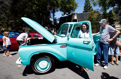 Dana Benyo checks out Jack Winchell's '65 Ford truck on display at the Saratoga Classic Car Show on Sunday, July 17, 2016, in Saratoga, Calif. 85-year-old Winchell says his father bought the vehicle from the San Jose Water Company 51 years ago. (Karl Mondon/Bay Area News Group)