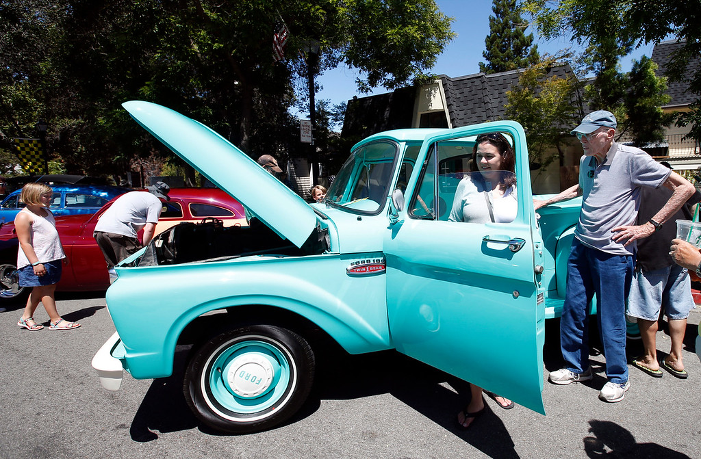 . Dana Benyo checks out Jack Winchell\'s \'65 Ford truck on display at the Saratoga Classic Car Show on Sunday, July 17, 2016, in Saratoga, Calif. 85-year-old Winchell says his father bought the vehicle from the San Jose Water Company 51 years ago. (Karl Mondon/Bay Area News Group)
