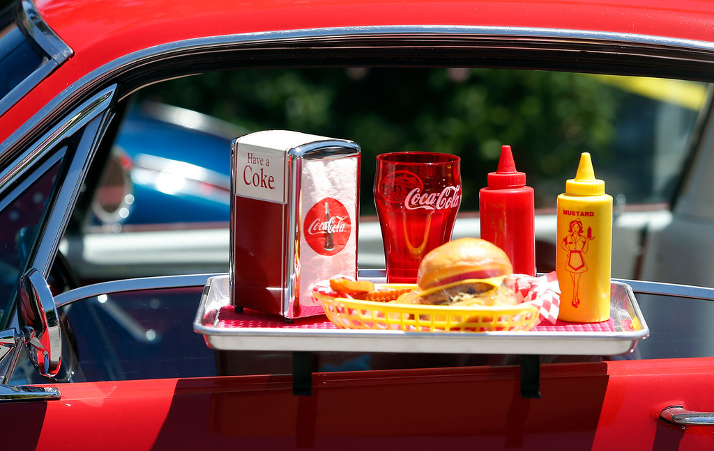 . A Coca Cola-themed side tray food display hangs on a Mustang entered in the Saratoga Classic Car Show in Saratoga, Calif., Sunday, July 17, 2016. (Karl Mondon/Bay Area News Group)