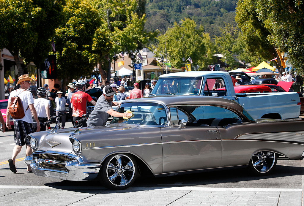 . Ramon Corio dusts off his \'57 Chevrolet Bel Air on display at the Saratoga Classic Car Show on Big Basin Way in Saratoga, Calif., Sunday, July 17, 2016. Corio had registered his \'37 Ford Roadster for the show, but he had transmission problems in the morning and he went back home for the \'57. It\'s good to have a spare classic. (Karl Mondon/Bay Area News Group)