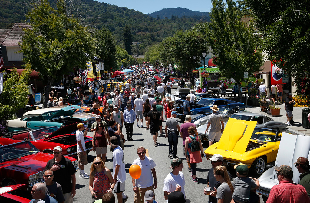 . Large crowds mill among the vehicles entered in the Saratoga Classic Car Show on Big Basin Way in Saratoga, Calif., Sunday, July 17, 2016. (Karl Mondon/Bay Area News Group)