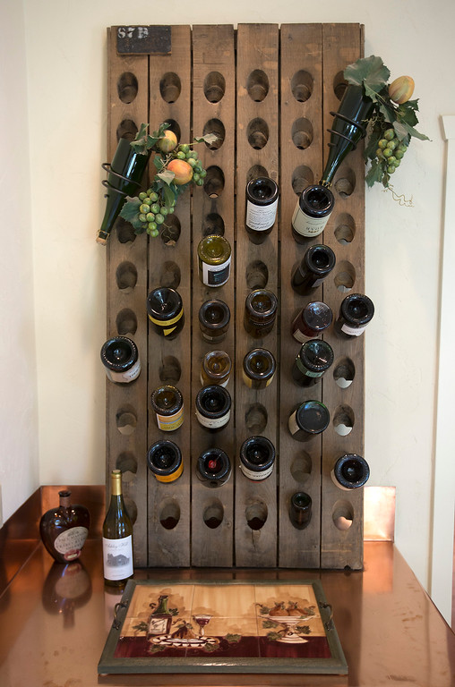 . A riddling rack holds wine bottles in Paul Masson\'s chateau in the hills above Saratoga, Calif., Thursday, Sept. 1, 2016. The house, on three acres, is on the market for $7 million and it is where Masson once entertained friends like Charlie Chaplin and John Steinbeck.  (Patrick Tehan/Bay Area News Group)