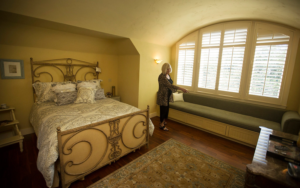 . Realtor Patricia Anderson gives a tour of the master bedroom in Paul Masson\'s chateau in the hills above Saratoga, Calif., Thursday, Sept. 1, 2016. The house, on three acres, is on the market for $7 million and it is where Masson once entertained friends like Charlie Chaplin and John Steinbeck.  (Patrick Tehan/Bay Area News Group)