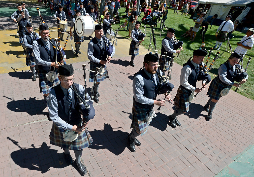 . The City of Sacramento Pipe Band play as they exit the competition area during the 148th annual Scottish Highland Gathering and Games held at the Alameda County Fairgrounds in Pleasanton, Calif., on Saturday, Aug. 13, 2013. The Scottish Highland Gathering and Games continues on Sunday. (Doug Duran/Bay Area News Group)