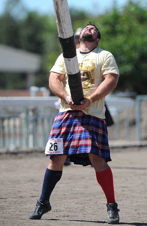 . Nick Kahanic, of Jamestown, New York, tosses the caber during the 148th annual Scottish Highland Gathering and Games held at the Alameda County Fairgrounds in Pleasanton, Calif., on Saturday, Aug. 13, 2013. Kahanic was competing in the Amateur A class caber toss. The Scottish Highland Gathering and Games continues on Sunday. (Doug Duran/Bay Area News Group)