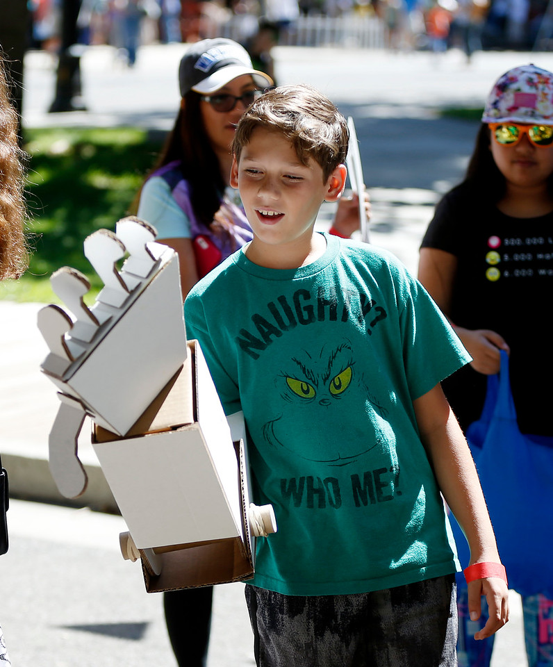 Spencer Helsing, 10, of San Jose, reacts as he tries out a robotic arm made of cardboard at the second annual San Jose Mini Maker Faire at History San Jose Park in San Jose, Calif., on Sunday, September 4, 2016. (Josie Lepe/Bay Area News Group)