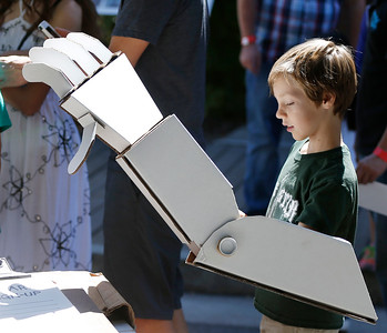 Carter Helsing, 8, of San Jose, tries out a robotic arm made of cardboard at the second annual San Jose Mini Maker Faire at History San Jose Park in San Jose, Calif., on Sunday, September 4, 2016. (Josie Lepe/Bay Area News Group)