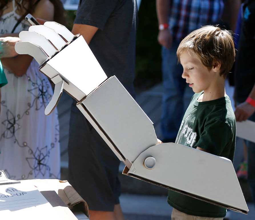 . Carter Helsing, 8, of San Jose, tries out a robotic arm made of cardboard at the second annual San Jose Mini Maker Faire at History San Jose Park in San Jose, Calif., on Sunday, September 4, 2016. (Josie Lepe/Bay Area News Group)