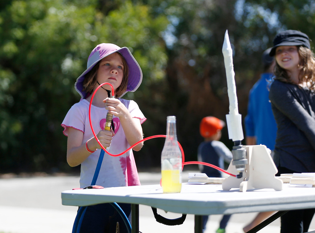 . Araya Dyakov, 6, gets ready to launch her rocket at the second annual San Jose Mini Maker Faire at History San Jose Park in San Jose, Calif., on Sunday, September 4, 2016. (Josie Lepe/Bay Area News Group)