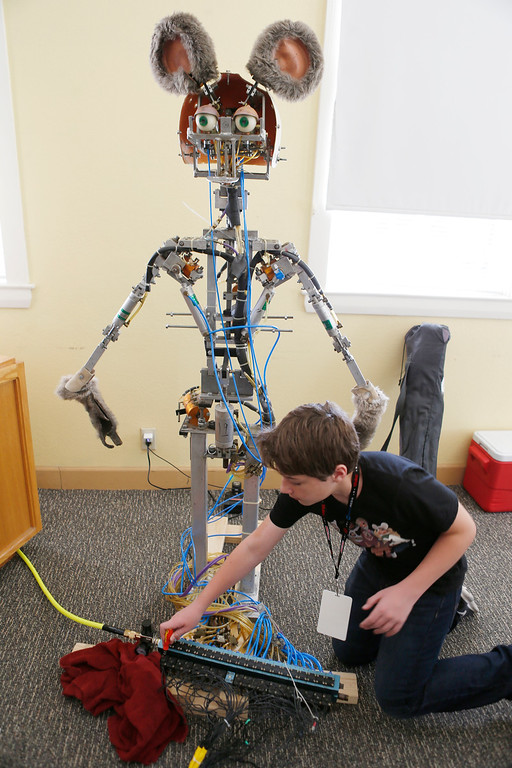 . Jack Turner, 13, works on his animatronic robot mouse at the second annual San Jose Mini Maker Faire at History San Jose Park in San Jose, Calif., on Sunday, September 4, 2016. (Josie Lepe/Bay Area News Group)