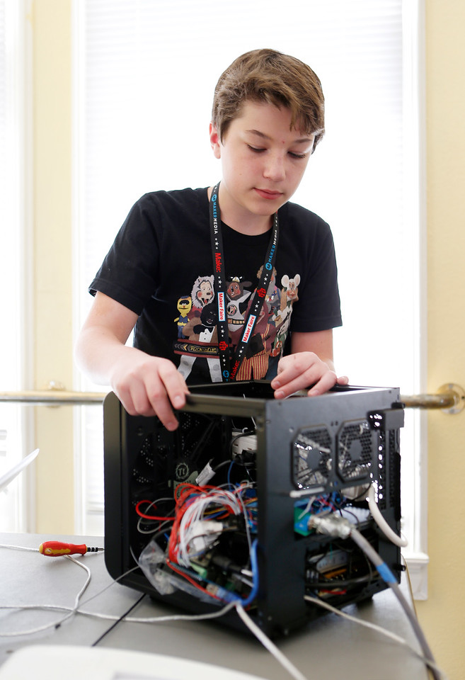 Jack Turner, 13, works on control box for animatronic robot mouse at the second annual San Jose Mini Maker Faire at History San Jose Park in San Jose, Calif., on Sunday, September 4, 2016. (Josie Lepe/Bay Area News Group)