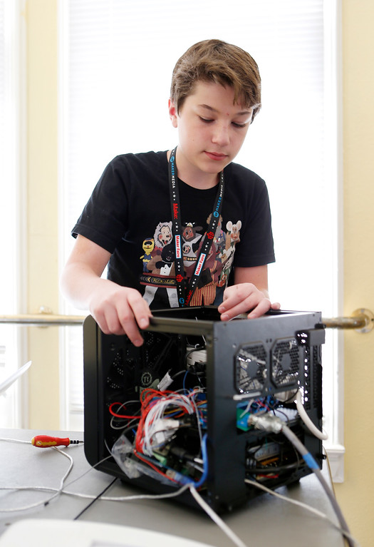 . Jack Turner, 13, works on control box for animatronic robot mouse at the second annual San Jose Mini Maker Faire at History San Jose Park in San Jose, Calif., on Sunday, September 4, 2016. (Josie Lepe/Bay Area News Group)