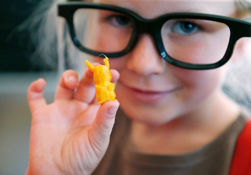 . Hannah Goldsmith, 6, shows off her 3D printout of pikachu pokemon at the second annual San Jose Mini Maker Faire at History San Jose Park in San Jose, Calif., on Sunday, September 4, 2016. (Josie Lepe/Bay Area News Group)
