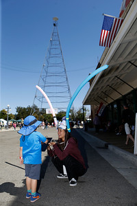 Kaori Yuda, 19, a student from University of Aizu in Aizu-Wakamatsu, Japan, demonstrates the application that controls a device using a phone jack, gluemotor.com, at the second annual San Jose Mini Maker Faire at History San Jose Park in San Jose, Calif., on Sunday, September 4, 2016. (Josie Lepe/Bay Area News Group)