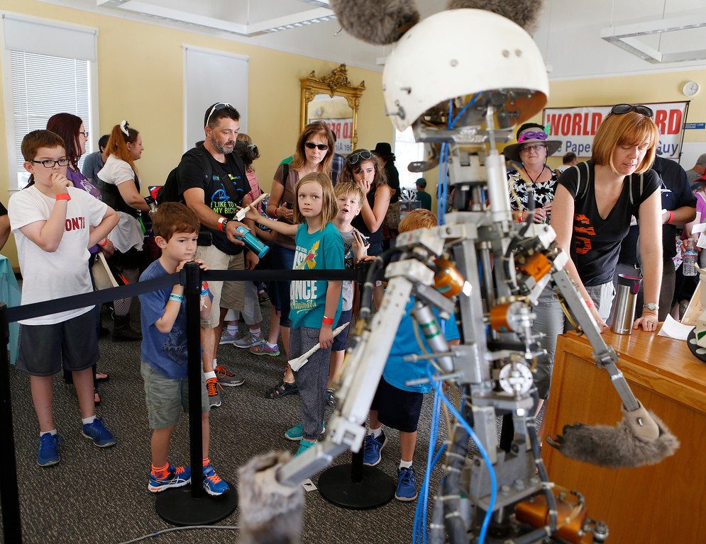 . People watch the animatronic robot mouse move at the second annual San Jose Mini Maker Faire at History San Jose Park in San Jose, Calif., on Sunday, September 4, 2016. (Josie Lepe/Bay Area News Group)